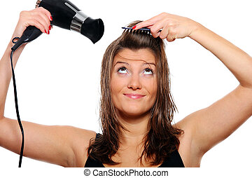Young woman drying hair - A portrait of a young pretty woman...