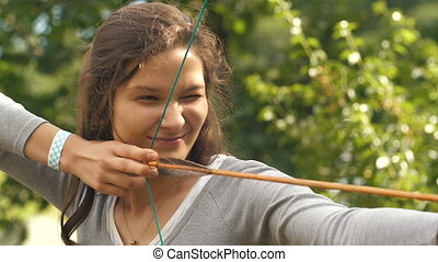 Woman making funny face after shooting an arrow - Athlete...