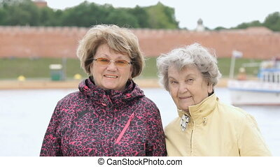 Portrait of two smiling adult women outdoors