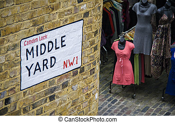 Middle Yard Street sign on a bricked wall in Camden lock...
