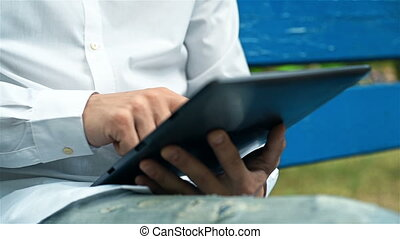Hipster Using Tablet - Hipster Using Touch Pad Outside. Slow...