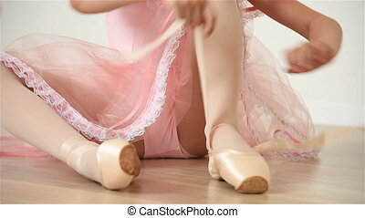 Little Ballerina In Pink Dress And Pointe Shoes Is Dancing...