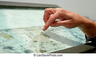 Hands forefingers pointing the places on touristic map....
