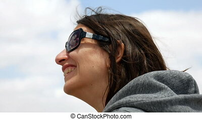 Longhair woman smiling and laughing outdoors - Longhair...