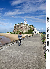 Nobby Lighthouse - Newcastle Australia - A woman walking...
