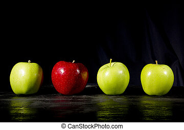 Red apple stands out - Red apple standing out in a row of...