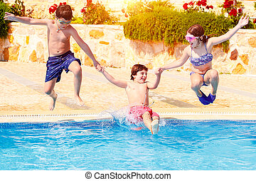 Happy children in the pool