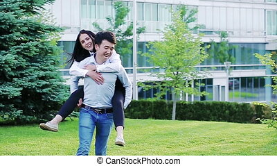 Happy office workers having fun outdoors in the park