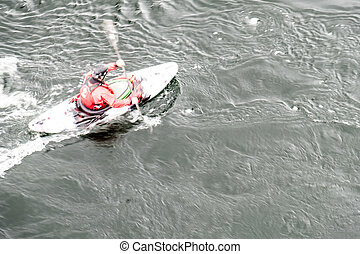 Blurred slow shutter speed shot of a canoe driver with copy space