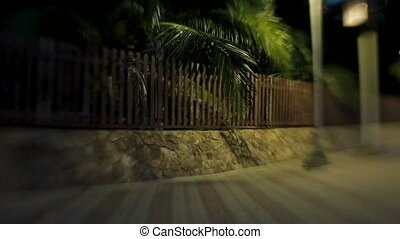 Alley along the sea, lit by lanterns. Shooted with Lens Baby...