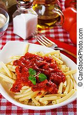 Italian macaroni pasta with tomato saucean oregano