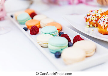 Candy bar on wedding ceremony. Decorated table with sweets...