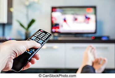 Men with the remote control, front of the television. - Men...