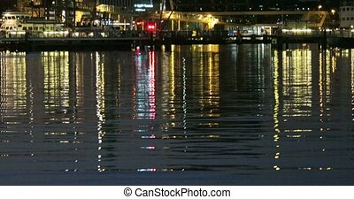 Reflective Night Lights on a Water Surface on the Kiel Week...