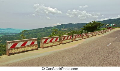 Mountain Asphalt Road with Barriers against Valley - camera...