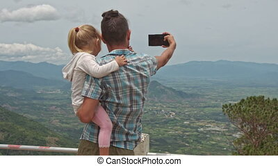 Father Holds Little Blond Daughter Photos Valley - backside...