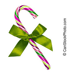 Purple candy cane with green bow, isolated on white