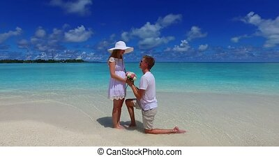 v07387 Maldives white sandy beach 2 people young couple man...
