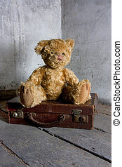 teddy bear on suitcase - teddy bear waiting on a suitcase to...