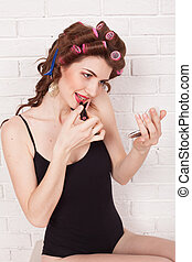 Woman with curlers talking on the phone makeup - Woman with...