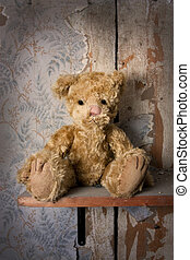 Lonely bear - Bear alone on a shelf in a old tattered room