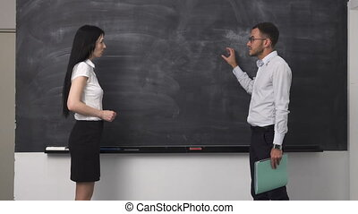 Business meeting, clean blackboard