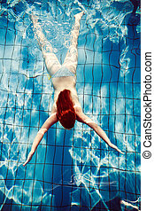 redhead girl dive in pool shot from above