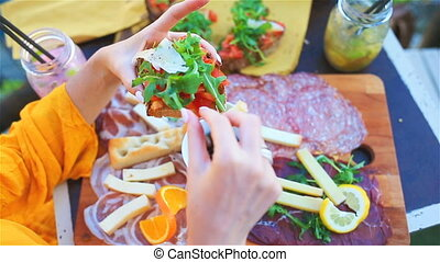 Tasty italian snack. Fresh bruschettes, cheeses and meat on...