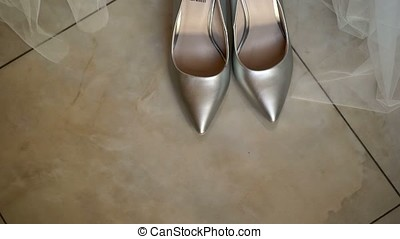 Bride wearing shoes - Bride wearing silver shoes indoors