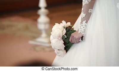 Unrecognizable bride with bouquet - Unrecognizable bride...