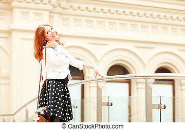 Woman with camera - Woman with an old vintage camera walking...
