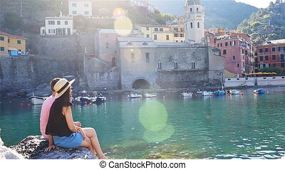 Young family in a cove on a rock in the Cinque Terre...