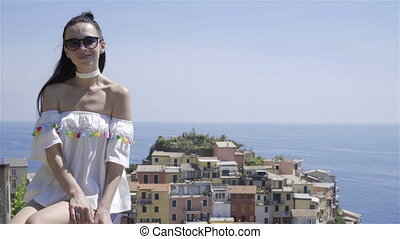 Young woman with beautiful view at old village in Cinque...