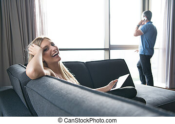 woman using tablet in beautiful apartment - Blonde Woman...