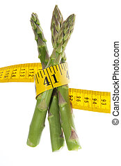 Healthy green fresh raw asparagus wrapped around a yellow...
