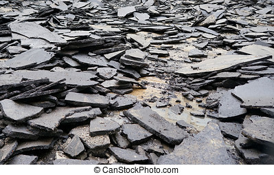 old broken asphalt in the city. road. earthquake, quake,...