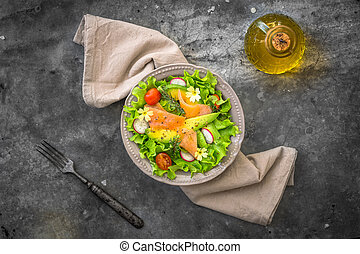 Salad with avocado and smoked salmon