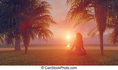 Woman in meditation yoga lotus pose on beach - Back view...
