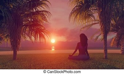 African woman meditating on tropical beach at sunrise - Back...