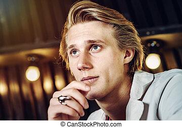 Young attractive guy posing in studio