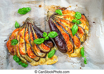 Italian traditional dish with eggplant, tomato and...