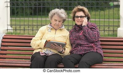 Two women discuss about home problems outdoors