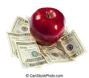 A red apple sits on top of a pile of $20 bills to illustrate the cost of education, food, or health care.  Studio shot on a white background.