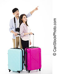 happy young couple with suitcase going on vacation