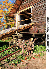 wooden cart near old building