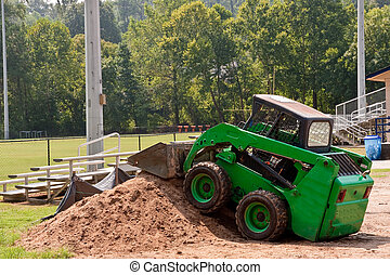 Green Earth Mover on Pile of Dirt