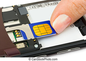 Hand install sim card to mobile phone isolated on white...