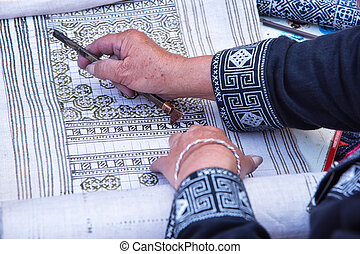 Hmong hilltribe draws pattern - Close-up female hand of...