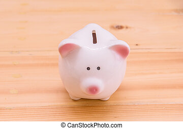 Piggy bank a container for saving money.