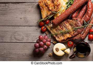regional products - still life with sausage, cheese and...
